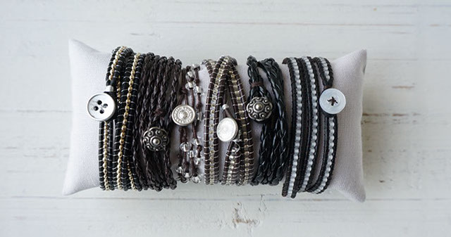 Dark brown bracelets with silver beads and string